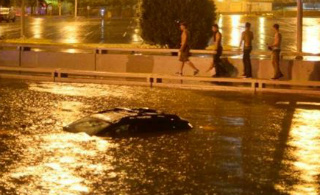 Car caught in Albuquerque downtown flooded street