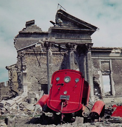 View of the ruins of the Palais de Justice in the town of St. Lo, France, summer 1944