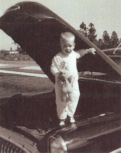 Tom Gilbert at age 2 under the hood of the family car