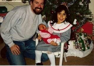 Kristen with her baby brother, Eric, at his first Christmas
