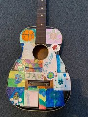 student gift to teacher of a decorated guitar