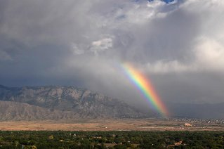 Sandia mountains with clouds and rainbow