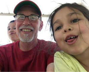 Tom Gilbert with silly selfie of grandkids June 2016